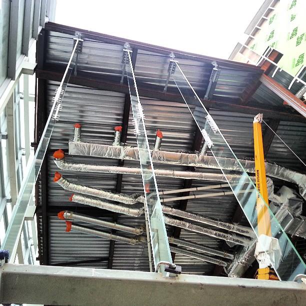 3 glass fins up today cobo convention Detroit construction glazinghellip